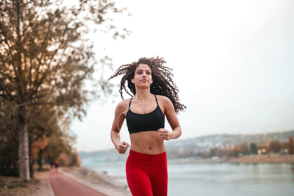 woman running with earbuds